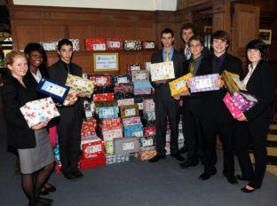 Students at Sherfield School with some of the shoeboxes they have collected
