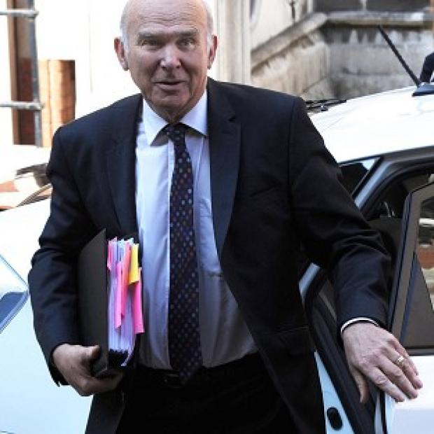 Business Secretary Vince Cable arrives to give evidence to the Leveson Inquiry into press standards