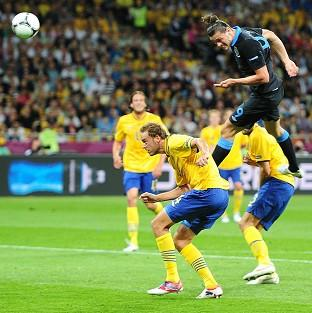 England's Andy Carroll scores the first goal of the Euro 2012 game against Sweden at the Olympic Stadium in Kiev, Ukraine