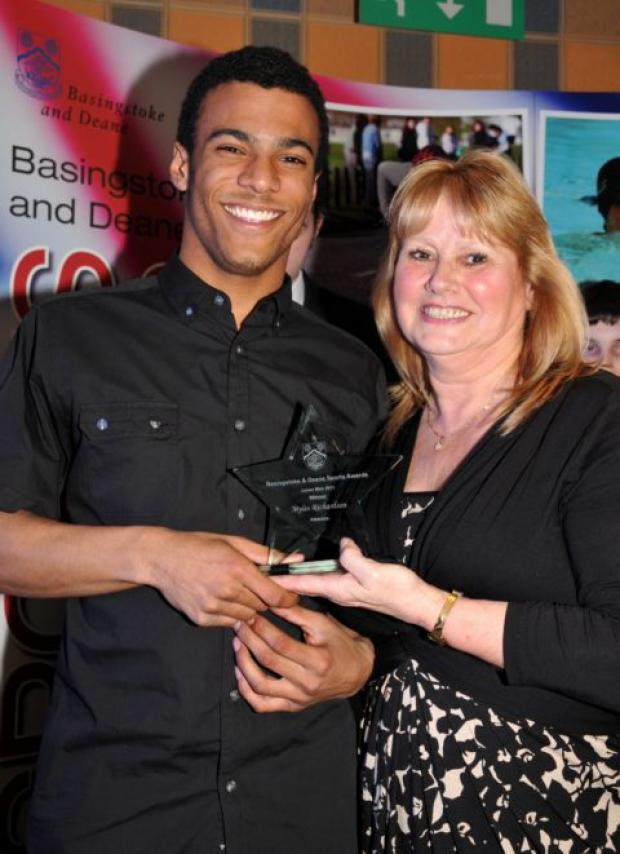 Myles Richardson receives his junior men's award