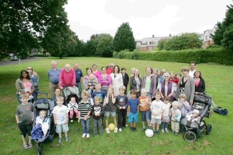 Abbotts Barton residents gather near Dyson Drive to oppose council plans to build new homes on the green space