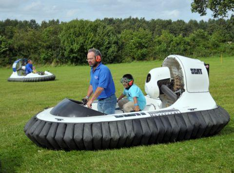 Youngsters enjoy a ride on a hovercraft