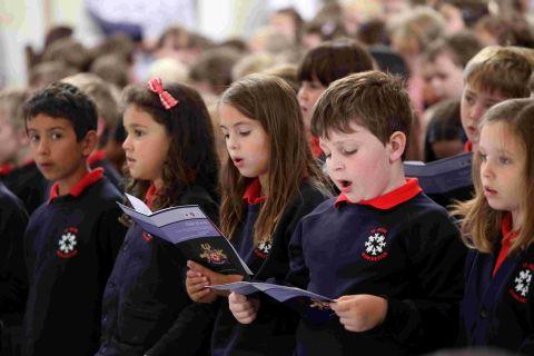 The children of St Bede sing at the centenary celebration. There are more photos of the service in this week's Hampshire Chronicle