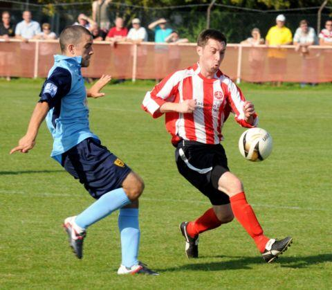 Tom Pemberton gave away two penalties as Whitchurch crashed out of the FA Vase.