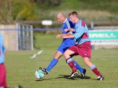 SHOW OF STRENGTH: Andy Harris, left, holds off a Hamworthy opponent