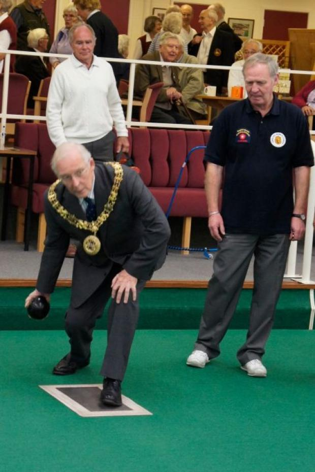 Mayor Frank Pearson delivers the first wood at Riverside Indoor Bowling Club ahead of the new season