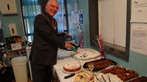 Mayor of Winchester Frank Pearson cuts the birthday cake at Rotherly House's 60th anniversary