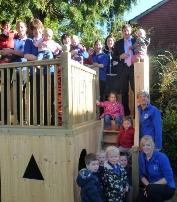 Steve Brine opens Yellow Dot Nursery in Otterbourne with staff, children and parents.