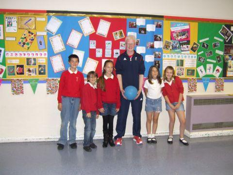 Paralympic goalball player Adam Knott (centre) visits pupils at All Saints Primary School in Winchester