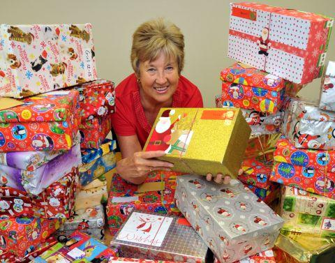 Gazette receptionist Anne Murphy with some of the shoeboxes