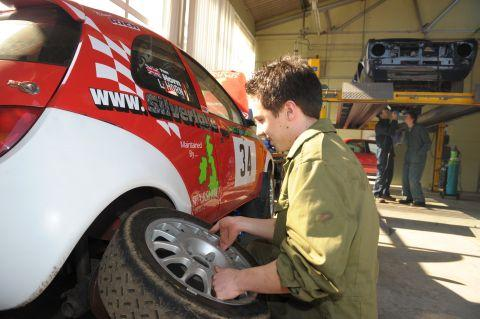 Sparsholt College students working on a rally car