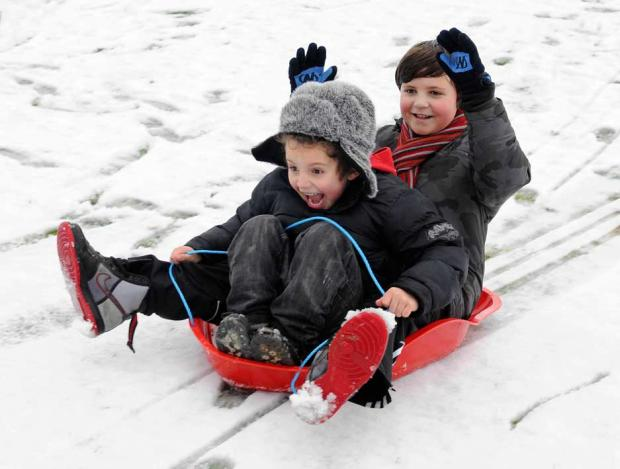 George and Jack Cotton pictured in 2012, having fun in the snow.
