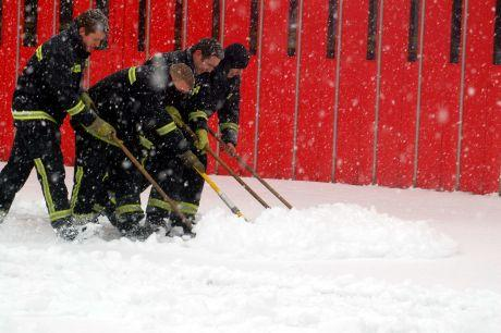 Clearing the snow at Basingstoke fire station. Pic by Paul King