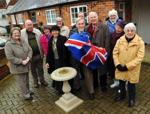 The Mayor and Mayoress Martin and Chansopha Biermann unveil a new sundial in the gardens of the Deanes Almhouses