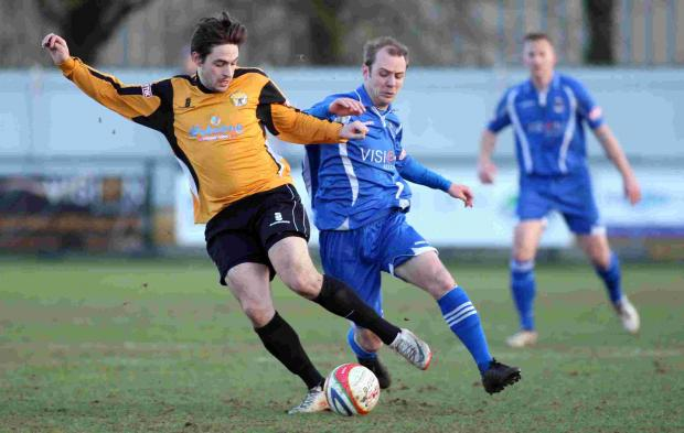 Action from the clash between Totton and Bashley