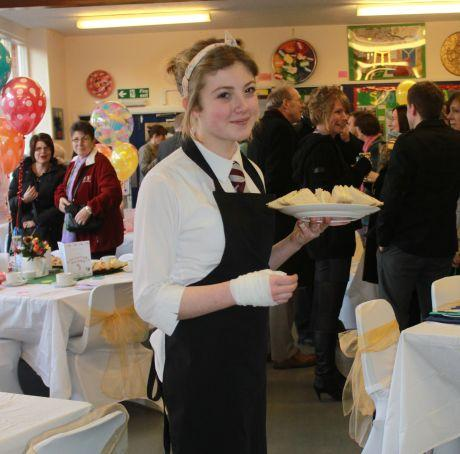 Student Annie Wood helps out at the tea party