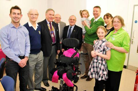 Molly Murray, centre, with her family and those who have helped purchase her wheelchair