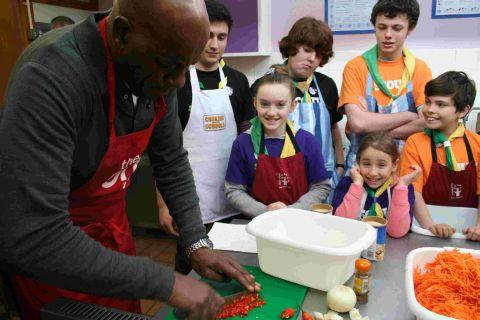Ainsley shows children from Wickham how it's done