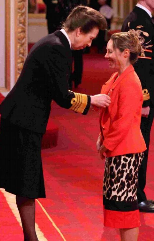 Helena Lucas proudly receives her medal from HRH the Princess Royal.